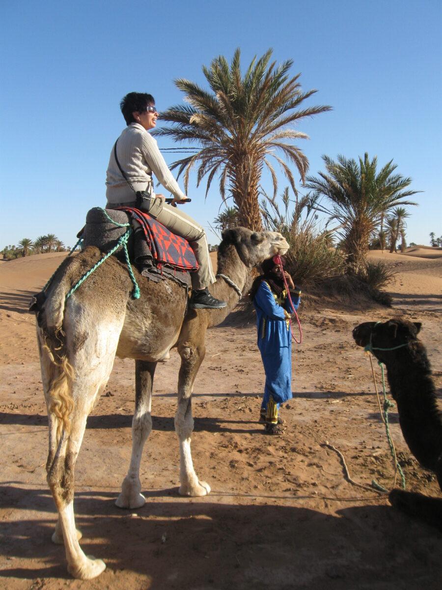 riding_camel_morocco_sahara